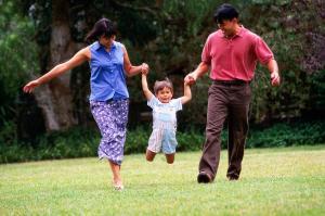 family walking on grass