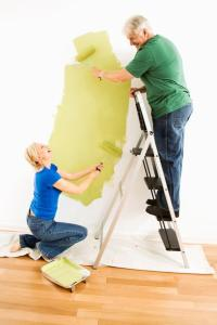 man and woman painting wall